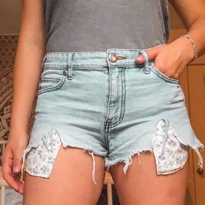 Free People denim shorts with floral pocket
